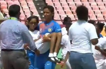 Watch Harmanpreet Kaur carry ill girl during match against Pak