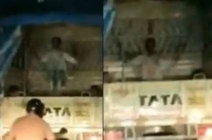Man Rides Swing in the Back of a Moving Truck in Mumbai Traffic